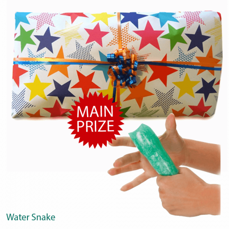 """<img src = """"http://www.partieswrappedup.co.uk/pass-the-parcel/fun-gift-option-3-unisex-pass-the-parcel-ready-made.html.jpeg"""" alt = """"Unisex Fun Gift Pass The Parcel Party Game"""" />"""